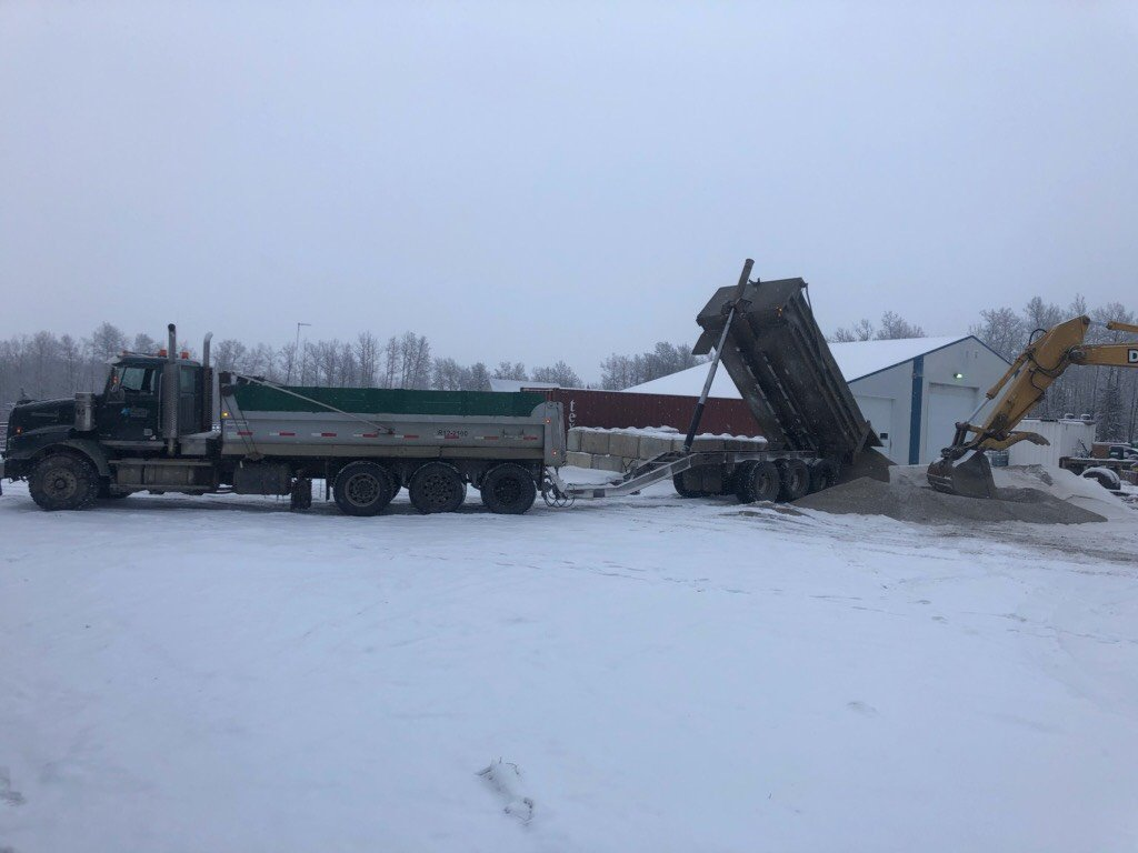 tandem-dump-truck-industrial-hauling-services-winter-construction-Northern-Vac-Services-Ft.-St-John.