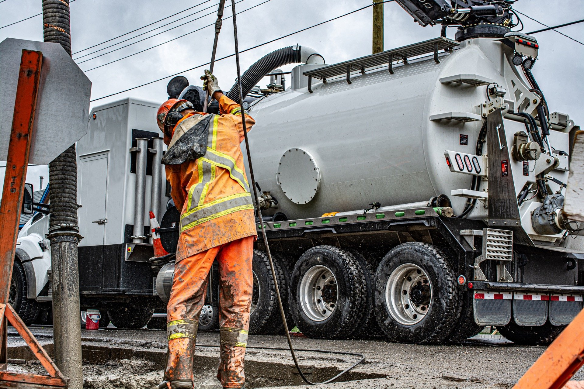 Combo vac truck cleaning up sludge in city